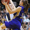 Holy Family's Alex Wilson goes for a lay up past Colorado Springs Christian's Sarah Guhl during Saturday's 3A state championship game at CSU's Moby Gym.<br /> <br /> <br /> March 13, 2010<br /> Staff photo/David R. Jennings