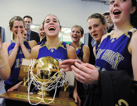 Carolina Gutierrez holds Holy Family's 3-peat state 3A state trophy after the team won Saturday's 3A state championship game against Colorado Springs Christian at CSU's Moby Gym.<br /> <br /> <br /> March 13, 2010<br /> Staff photo/David R. Jennings