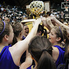 the Holy Family team raises the state 3A state trophy after  Saturday's 3A state championship game against Colorado Springs Christian at CSU's Moby Gym on Saturday.<br /> <br /> <br /> March 13, 2010<br /> Staff photo/David R. Jennings