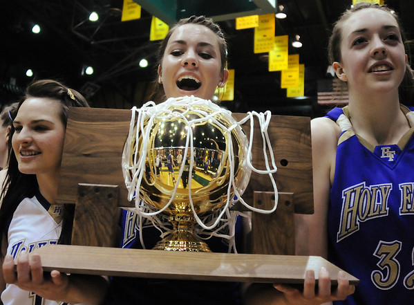Taylor Helbig looks at the state 3A state trophy after Holy Family defeated Colorado Springs Christian during Saturday's 3A state championship game at CSU's Moby Gym.<br /> <br /> <br /> March 13, 2010<br /> Staff photo/David R. Jennings