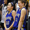 Holy Family's Carolina Gutierrez and Kassandra Johannsen watch the clock tick down for the team's 3-peat championship win against Colorado Springs Christian during Saturday's 3A state championship game at CSU's Moby Gym.<br /> <br /> <br /> March 13, 2010<br /> Staff photo/David R. Jennings