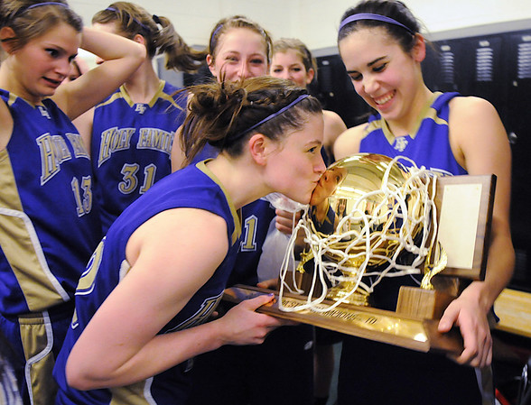 Molly Coogan kisses the state 3A state trophy held by Carolina Gutierrez after Holy Family defeated Colorado Springs Christian after Saturday's 3A state championship game at CSU's Moby Gym.<br /> <br /> <br /> March 13, 2010<br /> Staff photo/David R. Jennings