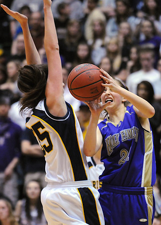 Holy Family's Sarah Talamantes goes to the basket against Colorado Springs Christian's Erika Heckman during Saturday's 3A state championship game at CSU's Moby Gym.<br /> <br /> <br /> March 13, 2010<br /> Staff photo/David R. Jennings