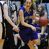 Holy Family's Sarah Talamantes drive to the basket  past Colorado Springs Christian's Tiffany Kenney during Saturday's 3A state championship game at CSU's Moby Gym.<br /> <br /> <br /> March 13, 2010<br /> Staff photo/David R. Jennings