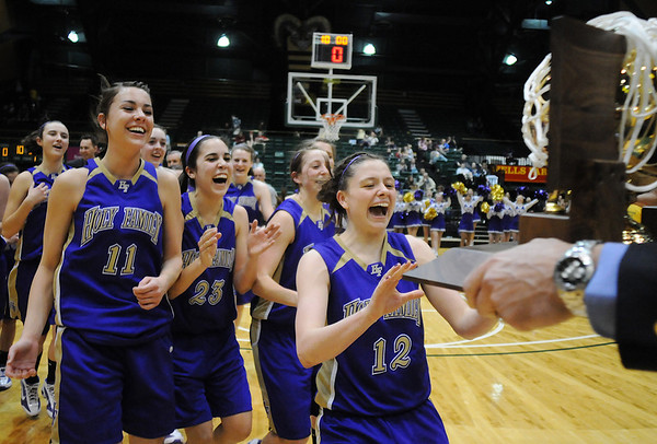 Taylor Helbig, left, Carolina Gutierrez and Molly Coogan rush to accept the state 3A state trophy after Holy Family defeated Colorado Springs Christian for the team's third state title Saturday at CSU's Moby Gym.<br /> <br /> <br /> March 13, 2010<br /> Staff photo/David R. Jennings