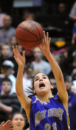 Holy Family's Carolina gutierrez goes to the basket  past Colorado Springs Christian during Saturday's 3A state championship game at CSU's Moby Gym.<br /> <br /> <br /> March 13, 2010<br /> Staff photo/David R. Jennings