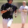 SP30PRPBASEBALL3A_MM_05-2-2.jpg Holy Family's Josh Tinnon rounds third base as he looks to score against Eaton High in the 3A Colorado State Baseball Championship game at Butch Butler Field in Greeley, Colo. on Saturday 05/29/10.  The game was called after the 5th inning when Holy Family went up 11-1 to clinch the victory.  (SPECIAL TO THE POST/ MATT MCCLAIN)
