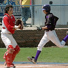 Holy Family's Louis Simpson runs to hole plate for a run past Russ Evans, Hotchkiss during Saturday's state palyoff game at Jackson Field in Greeley.<br /> May 21, 2011<br /> staff photo/David R. Jennings