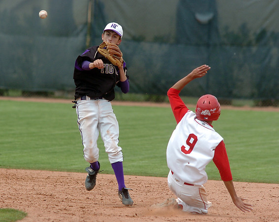 Holy Family's Louis Simpson throws to first base after tagging out Edgar Macias, Hotchkiss at second base during Saturday's state palyoff game at Jackson Field in Greeley.<br /> May 21, 2011<br /> staff photo/David R. Jennings