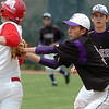 Holy Family's second baseman Louis Simpson tags out Aaron Leger,  Hotchkiss during Saturday's state palyoff game at Jackson Field in Greeley.<br /> May 21, 2011<br /> staff photo/David R. Jennings