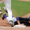 Holy Family Devlin Granberg slides safely back to first base past Dylan Ware, Hotchkiss during Saturday's state palyoff game at Jackson Field in Greeley.<br /> May 21, 2011<br /> staff photo/David R. Jennings
