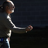 Ron Cito throws a bocce ball during a practice session at the 4th Annual Bocce Ball Tournament at Holy Family High School on Saturday.<br /> October 17, 2009<br /> Staff photo/David R. Jennings