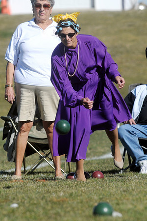 "BE1025BOCC09<br /> Julie Cavalier, dressed in costume for her team ""The Honeymooners"", bowls while Donna Loper, left, watches during the 4th Annual Bocce Ball Tournament at Holy Family High School on Saturday.<br /> October 17, 2009<br /> Staff photo/David R. Jennings"