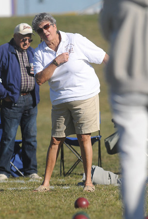 Donna Loper with the Anthem Ranch Bocce Team, watches the ball roll towards the pallina ball during the 4th Annual Bocce Ball Tournament at Holy Family High School on Saturday.<br /> October 17, 2009<br /> Staff photo/David R. Jennings