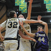 Holy Family's Kyle Willis goes to the basket against Colorado Springs Christian's Nick Burns and Kyle Broekhuis during the 3A state Great Eight Game at CSU on Thursday.<br /> <br /> March 8,  2012 <br /> staff photo/ David R. Jennings