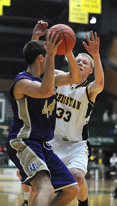 Colorado Springs Christian's Nate Engesser tries to block a pass by Holy Family's Kyle Willis during the 3A state Great Eight Game at CSU on Thursday.  March 8,  2012  staff photo/ David R. Jennings