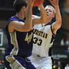 Colorado Springs Christian's Nate Engesser tries to block a pass by Holy Family's Kyle Willis during the 3A state Great Eight Game at CSU on Thursday.<br /> <br /> March 8,  2012 <br /> staff photo/ David R. Jennings