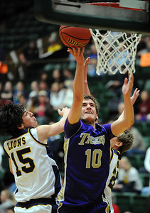 Holy Family's Tanner Stuhr goes to the basket against Colorado Springs Christian's Reagan Chapman during the 3A state Great Eight Game at CSU's Moby Arena on Thursday.  March 8,  2012  staff photo/ David R. Jennings
