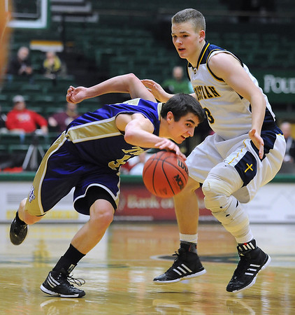 Holy Family's Chuck Hollwedel drives the ball downcourt against Colorado Springs Christian's Drew Wilbur during the 3A state Great Eight Game at CSU on Thursday.<br /> <br /> March 8,  2012 <br /> staff photo/ David R. Jennings
