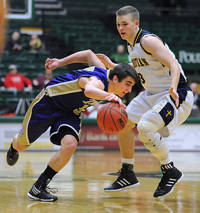 Holy Family's Chuck Hollwedel drives the ball downcourt against Colorado Springs Christian's Drew Wilbur during the 3A state Great Eight Game at CSU on Thursday.  March 8,  2012  staff photo/ David R. Jennings