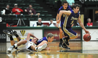 Holy Family's Chuck Hollwedel takes the ball down court after Gintas Jarasius collided with Colorado Springs Christian's Kyle Broekhuis during the 3A state Great Eight Game at CSU on Thursday.  March 8,  2012  staff photo/ David R. Jennings