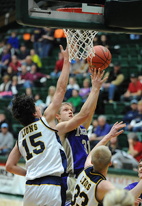 Holy Family's Gintas Jarasius shoots the ball against Colorado Springs Christian's Reagan Chapman during the 3A state Great Eight Game at CSU on Thursday.  March 8,  2012  staff photo/ David R. Jennings