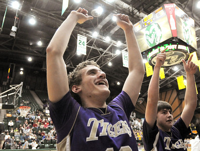 Holy Family's Tanner Stuhr cheers after the tiger defeated  Colorado Springs Christian 61-41 in the 3A state Great Eight Game at CSU on Thursday.  March 8,  2012  staff photo/ David R. Jennings