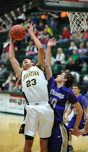 Colorado Springs Christian's Kyle Broekhuis rebounds the ball against Holy Family's Tanner Stuhr during the 3A state Great Eight Game at CSU on Thursday.  March 8,  2012  staff photo/ David R. Jennings