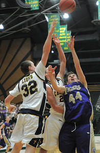 Holy Family's Kyle Willis goes to the basket against Colorado Springs Christian's Nick Burns and Kyle Broekhuis during the 3A state Great Eight Game at CSU on Thursday.  March 8,  2012  staff photo/ David R. Jennings