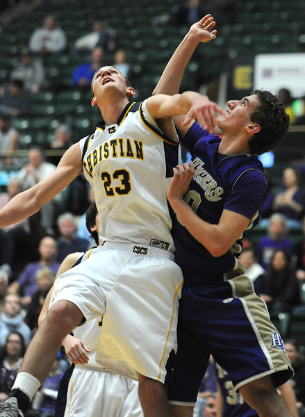 Holy Family's Tanner Stuhr and Colorado Springs Christian's Kyle Broekhuis fight for the ball under the basket during the 3A state Great Eight Game at CSU on Thursday.<br /> <br /> March 8,  2012 <br /> staff photo/ David R. Jennings