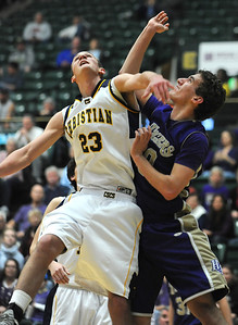 Holy Family's Tanner Stuhr and Colorado Springs Christian's Kyle Broekhuis fight for the ball under the basket during the 3A state Great Eight Game at CSU on Thursday.  March 8,  2012  staff photo/ David R. Jennings