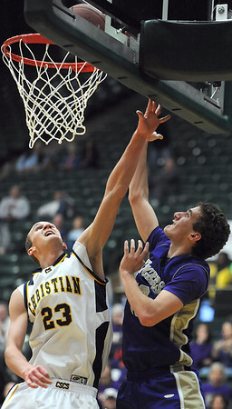 Holy Family's Tanner Stuhr gets to the basket against Colorado Springs Christian's Kyle Broekhuis during the 3A state Great Eight Game at CSU on Thursday.<br /> <br /> March 8,  2012 <br /> staff photo/ David R. Jennings