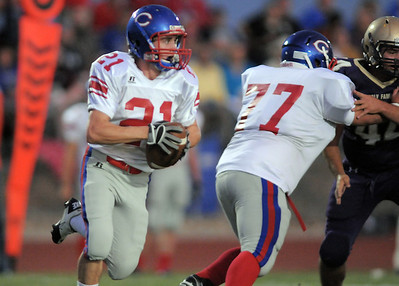 Trevor Schrader,Centaurus, carries the ball downfield against Holy Family during Friday's game at Michael G. Gabriel Stadium. September 23, 2011 staff photo/ David R. Jennings