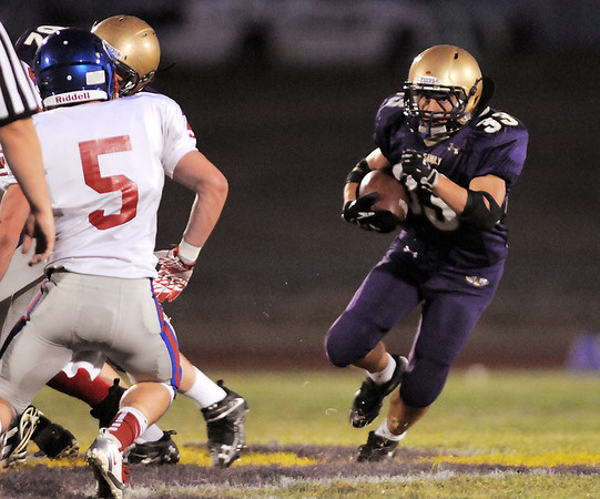 Connor Clay,  Holy Family, carries the ball downfield against Centaurus during Friday's game at Michael G. Gabriel Stadium.<br /> September 23, 2011<br /> staff photo/ David R. Jennings