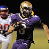 Chuck Howedel, Holy Family, runs downfield ahead of Jared Gallegos, Centaurus, during Friday's game at Michael G. Gabriel Stadium.<br /> September 23, 2011<br /> staff photo/ David R. Jennings