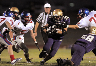 Connor Clay,  Holy Family, carries the ball through a hole in the Centaurus line during Friday's game at Michael G. Gabriel Stadium. September 23, 2011 staff photo/ David R. Jennings