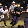 Connor Clay,  Holy Family, carries the ball through a hole in the Centaurus line during Friday's game at Michael G. Gabriel Stadium.<br /> September 23, 2011<br /> staff photo/ David R. Jennings