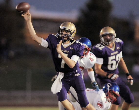 Quarterback Davis Sommers, Holy Family, throws a pass on the run against Centaurus During Friday's game at Michael G. Gabriel Stadium.<br /> September 23, 2011<br /> staff photo/ David R. Jennings