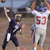 Holy Family quarterback David Sommers throws a pass over Shane Ellington, Centaurus, during Friday's game at Michael G. Gabriel Stadium.<br /> September 23, 2011<br /> staff photo/ David R. Jennings