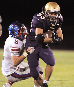 Connor Clay, Holy Family, tries to break a tackle from Jansen Scott, Centaurus, during Friday's game at Michael G. Gabriel Stadium. September 23, 2011 staff photo/ David R. Jennings