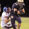 Connor Clay, Holy Family, tries to break a tackle from Jansen Scott, Centaurus, during Friday's game at Michael G. Gabriel Stadium.<br /> September 23, 2011<br /> staff photo/ David R. Jennings