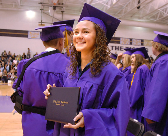 Kayla Brienza holds her diploma during Wednesday's Holy Family High School graduation ceremony.<br /> May 18, 2011<br /> staff photo/David R. Jennings