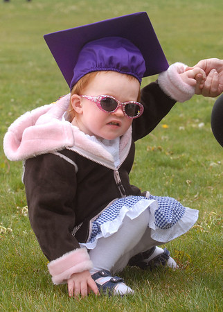 Kyla Snow 21 months-old, wears the cap of her second cousin, Erica Severino after Wednesday's Holy Family High School graduation ceremony.<br /> May 18, 2011<br /> staff photo/David R. Jennings