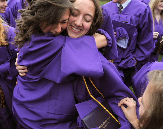 Dana Sanelli, right, is hugged by Anna Plonski after Wednesday's Holy Family High School graduation ceremony.<br /> May 18, 2011<br /> staff photo/David R. Jennings