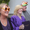 Kelsea Scherr, center, poses with her parents Shellee and Kyle wearing Holy Family tiger paraphernalia after Wednesday's Holy Family High School graduation ceremony.<br /> May 18, 2011<br /> staff photo/David R. Jennings