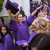 Taylor Helbig, center, reaches to gives her friends a hug after Wednesday's Holy Family High School graduation ceremony.<br /> May 18, 2011<br /> staff photo/David R. Jennings