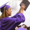 Taylor Helbig cheers for a classmate after accepting her diploma during Wednesday's Holy Family High School graduation ceremony.<br /> May 18, 2011<br /> staff photo/David R. Jennings