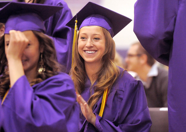 Sarah Talamantes claps for a classmate during Wednesday's Holy Family High School graduation ceremony at the school.<br /> May 18, 2011<br /> staff photo/David R. Jennings