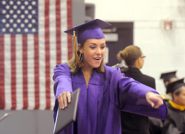 Taylor Helbig celebrates after receiving her diploma during Wednesday's Holy Family High School graduation ceremony at the school.<br /> May 18, 2011<br /> staff photo/David R. Jennings