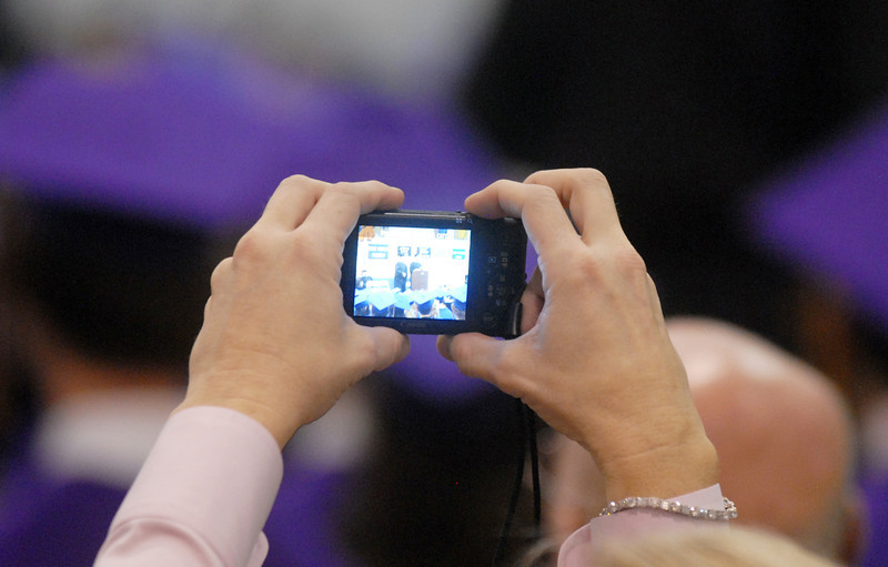 A family member photographs the graduation ceremony on Wednesday at Holy Family High School.<br /> May 18, 2011<br /> staff photo/David R. Jennings